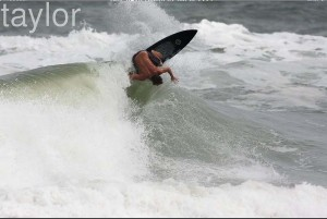 Dave Chambers... Backside attack in New Smyrna on the 5`11 Doc AVISO