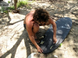 Setting my board up as a quad before paddling out... This board is amazing as a four fin!