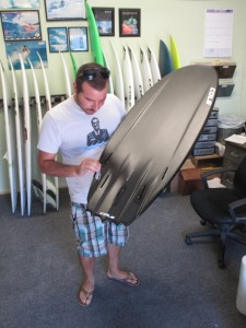 Robo inspecting the fin setup on the new 5`9!