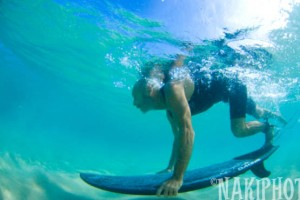 Push your board down deep and dive! Use your foot to help...