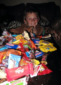 My nephew ethan with enough candy to last him until next Halloween