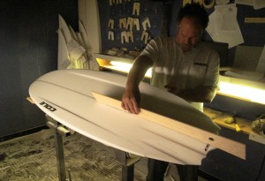Making sure the rocker is perfect. This board has a super flat rocker for insane speed!